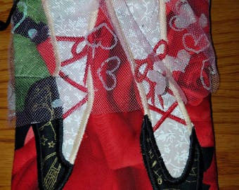 Zipper ballerina bag.  Red rose background with black slippers with musical theme.