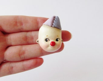 Cutie the Kewpie Clown - Paperclay Doll Face Pin
