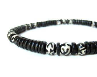 """Men's necklace handmade with black wood beads and batik dyed bone. """"Om Necklace"""""""