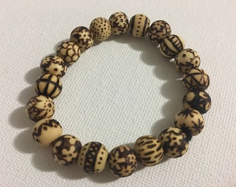 Hand burned wooden beaded bracelet
