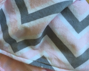 "lovey blanket in a pink and gray chevron , it measures 17""x20."