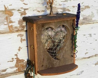 Rustic, primitive, Bird nesting box material holder for building nests. Holds string, dryer lint, twine. Rustic, hangs or stands. Songbird.