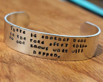 Anne of Green Gables - There is another bend in the road after this. ... -  Metal Stamped Cuff Bracelet - LM Montgomery