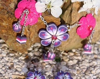 Purple and pink flowers set made of polymer clay.