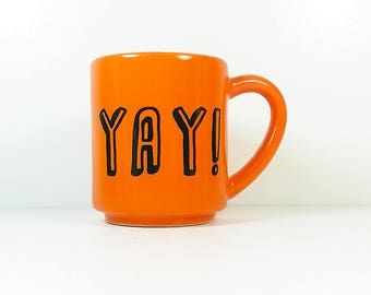 "15oz coffee mug/tea mug with giant ""YAY!"" on both sides, shown here in Creamsicle glaze. Made to Order/Pick Your Print/Pick Your Glaze"