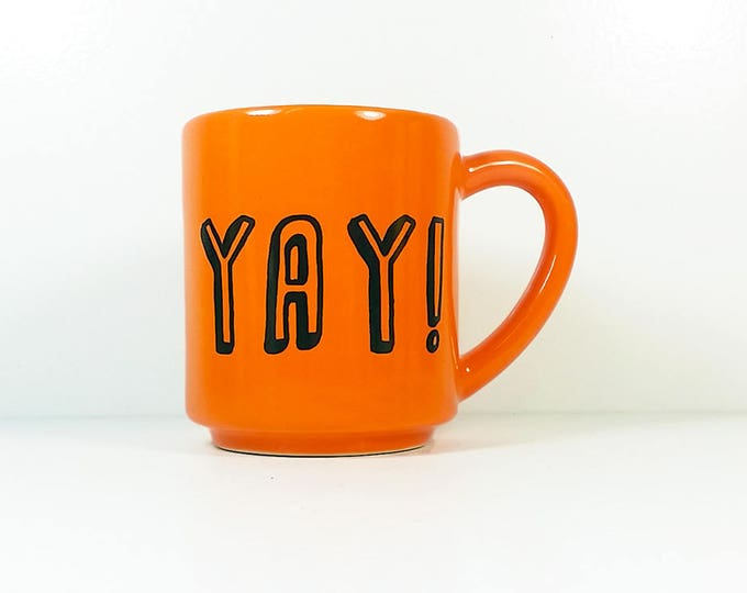 "Featured listing image: 15oz coffee mug/tea mug with giant ""YAY!"" on both sides, shown here in Creamsicle glaze. Made to Order/Pick Your Print/Pick Your Glaze"
