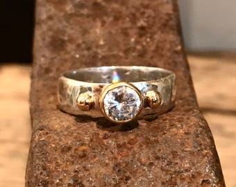 White topaz ring set in 14k gold and wide sterling silver band