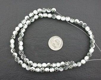 6mm white / black flower glass beads