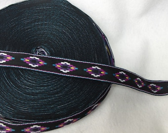 "AM002 -Diamant Morado 12MM, APROX 1/2"" wide, Black ribbon with Purple Aztec design.  Aprox25+ Y roll"