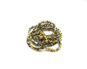 1 strand of approximately 210 beads, yellow glass 4 / 5mm