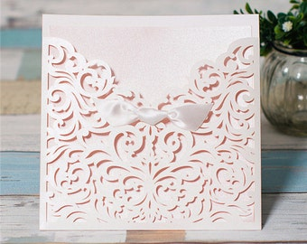 White Laser Cut Wedding Invitations. Pocket Style Wedding Invitation. Satin Ribbon Detail. Peal White Luxe Wedding. Laser Cut.