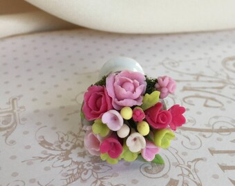 Miniature bouquet of flowers in porcelain jar