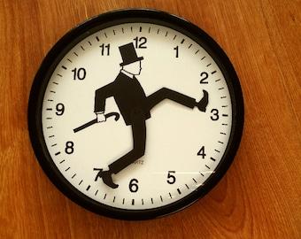 silly walk clock novelty clock funny wall clock black and white clock