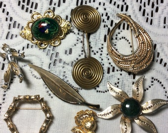 Eight Vintage Gold Tone Brooches
