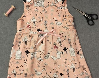 Sweet baby dress with circus print