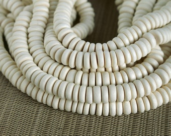 10mm White Wood Pucalet Rondelle Beads - Bleached - 15 inch strand