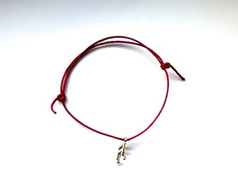 silver musical note charm on waxed cotton cord adjustable friendship bracelet