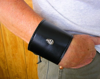 """Lace-up Leather cuff bracelet in Black with Skull, grommets and leather ties, 8 1/2"""" adjustable to 9 3/4"""" at wrist, 2 3/4"""" wide"""