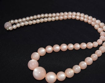 Vintage Pink Moonglow pearl necklace. Great spring color. Pink lucite beaded necklace.