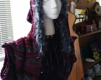Hand crocheted small/medium-sized fur hooded shrug. Multi colored maroon,grey and black with matching hat.
