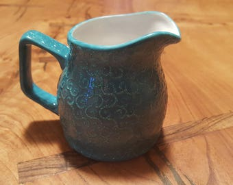 Swirls cream jug