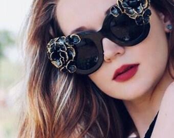 Woman black decorated sunglasses.