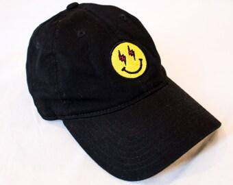 J BALVIN Energia Dad Hat, Smiling Emoji Face Lighting Bolt Eyes Smile Energy Design