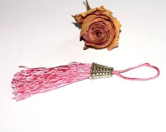 Pink cotton tassel twisted 12 cm x 2 cm.