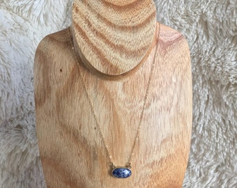 Gold and blue stone pendant necklace