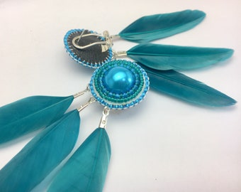 Teal / blue pearl and feather earrings