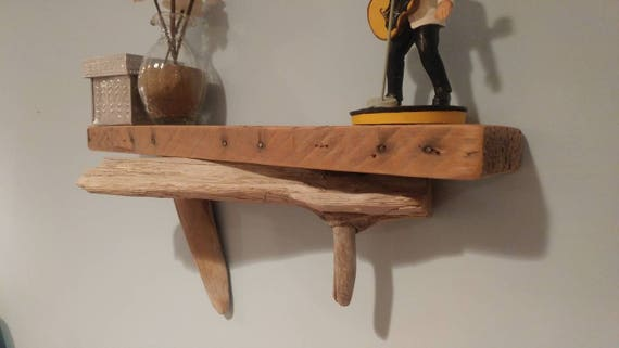 Handmade wall shelf with shipping palletwood top shelf and driftwood accents.