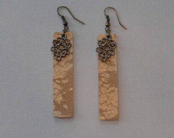 Gold splatter leather earrings.  Includes an antique gold dangle.