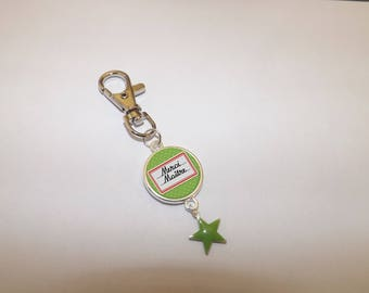 """""""thank you master"""" with an enamel star keychain"""