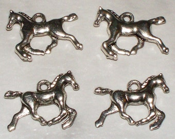 4 Antiqued Silver Galloping Horse Charms
