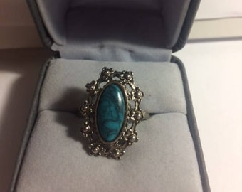 Silver ring with turquoise stone