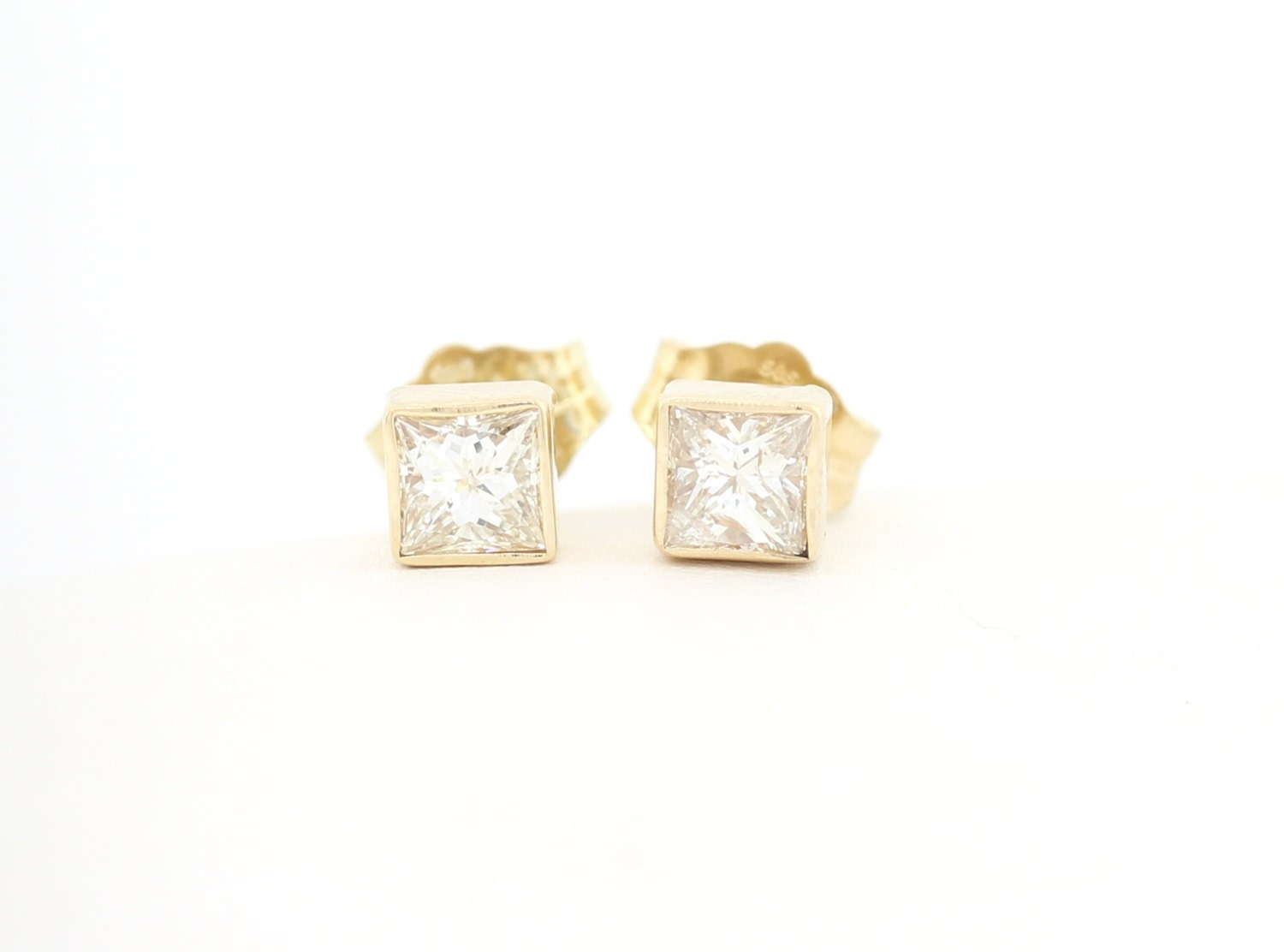 white stone princess p set cut asp earrings diamond stud gold rubover