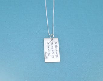"Sterling Silver Quote Charm. ""Be the change you wish to see in the world"" by Ghandi on an 18"" sterling silver box chain."