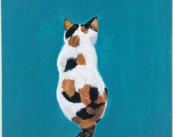 A Tortoiseshell Cat in Turquoise Blue