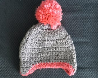 Crochet baby hat with ear flaps and pom pom