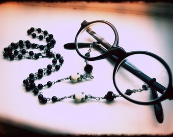 Gothic Eyeglass or Glasses Chain. Upcycled Rosary with Skulls and Crystals. Morbid Librarian Chic. MADE TO ORDER