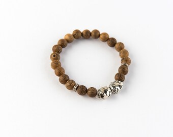 Vexed Soul Millettia Laurentii Wood Bead Bracelet with Polished Steels Skulls