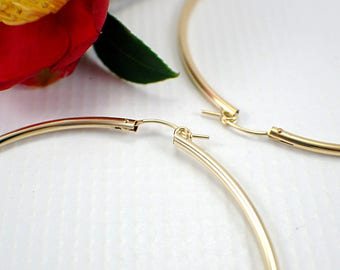 70mm 14k gold filled hoop earrings extra large size 2.75 inch 2mm hollow tube hoop earrings lightweight yellow gold hoop round lever closure