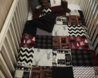 Woodland patchwork deer head quilt. Plush fabric backing.