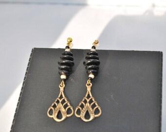 Art Nouveau black and gold dangle earrings.
