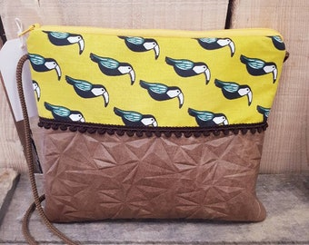 Toucans clutch bag