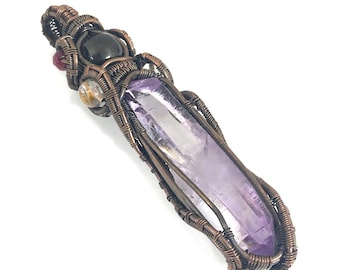 Vera Cruz Amethyst crystal pendant with Jet, Golden Rutile In Quartz and Ruby.  An Amulet Of Connection, Purification, Protection & Passion