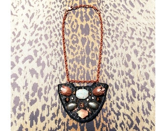 The MINI SHIELD NECKLACE by Gilded-Mane: Rose Gold Brass Tulips, African Turquoise, Pyrite and Glass Beads on Black Leather, Small