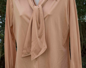 Vintage long sleeved blouse circa 1960's by jersey masters.