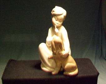 LLadro Girl Quieting Puppy