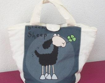 round basket in ecru fabric and sheep pattern